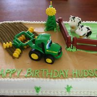 John Deere Tractor Farm Cake THIS IS ONE OF MY FAVORITES I DID FOR A FRIEND. SHE BROUGHT ME THE TOYS, AND I JUST HAD A BLAST DECORATING AROUND THEM.