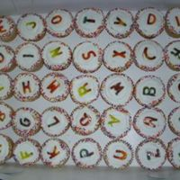 End Of School Cupcakes Mix of white and chocolate cup cakes with BC. Letters where cut out of tie died fruit roll ups.