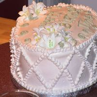 Lilies This cake is made with boiled icing and topped with Royal Icing Lilies.