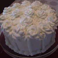 White Roses On White Cake Like my chocolate one this is bc roses on a white cake with vanilla pudding in the middle. Loved this cake, I think it was the best yet.