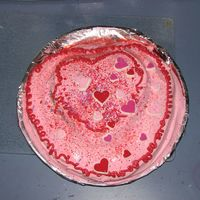 Valentine Heart Cake My 4 1/2 year old son loves to help his mom in the kitchen...especially with cakes. We made this Duncan Hines strawberry heart cake...