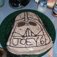 Darth Vader This cake was made by me for my son Joey's 6th birthday. I used the Wilton Darth Vader pan. It's a chocolate cake with raspberry...