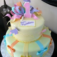 "Butterfly Birthday Cake 12"" and 8"" round cakes, covered in fondant, decorated w gumpaste bows and butterflies, and number one."