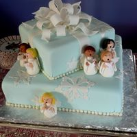 "Angel Choir Cake 14"" and 8"" square cake, covered in fondant, w/ gumpaste bow. Little angels were made out of fondant. The bow and snowflakes were..."