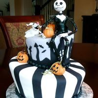 "Nightmare Before Christmas Sculpted frm 9-10"" rounds, and 5-6"" rounds, covered in fondant w/ gumpste Jack and pumpkins, and dog zero. Fun cake to make!"