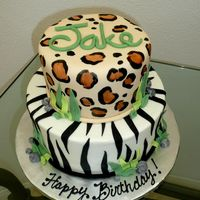 "Animal Print Birthday Cake 9"" and 6"" cakes. Did the bottom in buttercream w/ fondant stripes, top in fondant, w/ leopard print (painted). I would..."