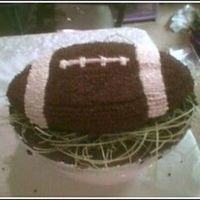 Football Cake This was my first BC cake...I did it for my BF's BDay...His family really loved it...Getting the right coloring was somewhat of a...
