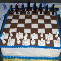 Chess Game This is another cake for my cousins graduation party. He is big into chess and wanted a chess game for one of his cakes. I used chocolate...