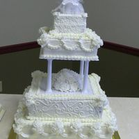 "50Th Anniversary Cake Cake was 4 tiers all squares 6"", 10"", 14"" and 18"" all white with white roses and leaves. She wanted dots on the top..."
