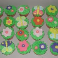 Garden Party Cupcakes! These cupcakes were for a little girl's birthday garden party, the green grass is buttercream, and the flowers and butterflies are...