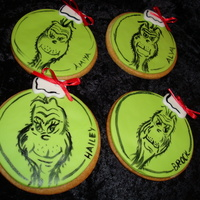 Grinch Cookies NFSC w/ fondant and hand painted Grinches. For my daughter's Whobilation party.