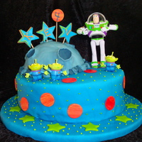 Buzz Lightyear All edible except the figurines. I am blaming the slope of the bottom cake on the moon's lack of gravity. Or something like that. It&#...