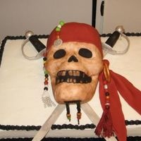 Pirates Of The Caribbean 2-12x18 cakes one chocolate the other vanilla. Iced in BC ALL details are done in fondant except for the maroon tassel.