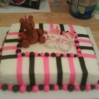 Punk Baby Shower chocolate cake and butter cream. The bear, stripes and balls were made with fondant. The shoes were made with gum paste.