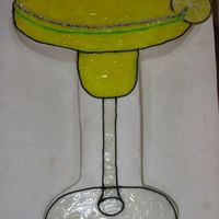 Margarita 12x18 yellow cake cut glass shape. Iced with BC and piping gel tinted with yellow and a touch of green.