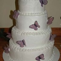 Butterfly Weddin Cake   This was my first wedding cake. I used the article from here on how to make edible butterflies but I used Vellum paper instead.
