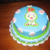 Chicken Little  color flow image with fondant cover ... I made this with my friend and partner in crime .. it was our first attempt at a stacked cake .. we...