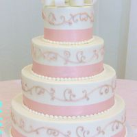 Wedding Cake With Pink Swirls And Looped Bow