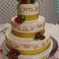 Round Wedding Cake With Pink And Gold Piping