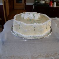 First Sold Cake This cake was made for a bridal shower. It is a double layer marble 15inch petal pan, Ivory icing with white trim and juniper green leaves...