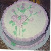 Wilton Rose Cake This was my first Wilton Cake I made at the end of Course I. White cake with vanilla filling.