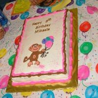 Monkey Birthday Cake Choc cake w/ banana & custard filling. Frosted w/ whipped cream. FBCT monkey and royal icing letters.