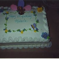 Birthday Cake This is Chocolate cake with bannana custard filling. Decorated with whip cream. Behind is a flower made of royal icing.