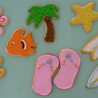 Hawaiian Themed Cookies I made 6 DOZEN of these ( in addition to the cupcakes) as a donation for a dear friend who works with a group of at risk girls....they are...