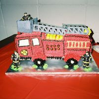 Firetruck This was also one of my beginner cakes. I made this firetruck for my son. The ladderbroke in transit to the firehouse. This was also before...