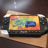 Psp Friend asked for a cake shaped like a PSP for her son's birthday. Iced in buttercream, buttons in fondant. Birthday boy loved it.