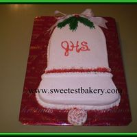Jingle Bells Marble cake. BC icing and decorations with wired bow at the top.