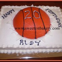 Basketball Bustin' Thru White cake, buttercream icing, fondant accents showing cake busting throuhg.