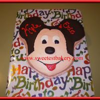M-I-C-K-E-Y M-O-U-S-E Mickey pan with buttercream icing and chocolate fondant details.
