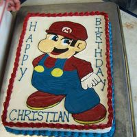 Super Mario Cake Super Mario themed birthday cake for a young boy.
