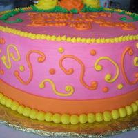 Bright Birthday Bright pink birthday cake with bright orange and yellow.