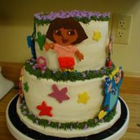 "Dora Tiered First attempt at ""chocolate transfer"". Turned out ok. The mom loved it! For a little girl's 2nd b-day. I know there are &..."