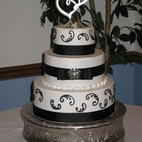 Black And White Buttercream iced/scroll. Ribbon