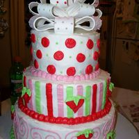 Girls Birthday Pink Red Cake this is a spin on the strawberry short cake fondant cake bt this is butter cream with a fondant bow.