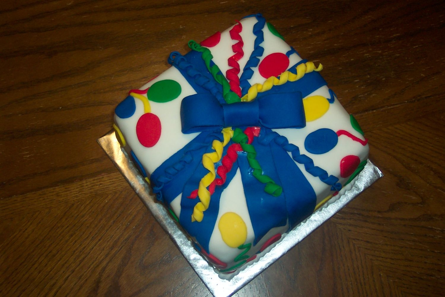 Wilton 3 Class Cake This was the cake I made while learning how to use fondant in Course 3. I sent it in for my sons birthday which worked really well. The...