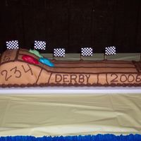 Cub Scout Pinewood Derby  This was a cake that I made for my sons cub scout pack for their Pinewood Derby. It was a yellow cake with chocolate buttercream frosting...
