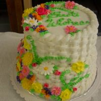 Best Wishes Cake I made this with the leftover flowers that I had from Course 2 for a Retirement party at my husbands office. Its a little off-centered,...