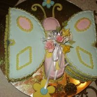 Mia's Butterfly  I made this cake for my granddaughter's 6th month b-day. It was chocolate/marble cake with mmf and lemon icing. The flowers are gum...