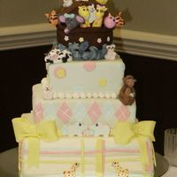 Noah's Arc Babyshower Cake  The couple don't know the gender of the baby so I was able to usethe pink, yellow and blue together. Everything in this cake is edible...