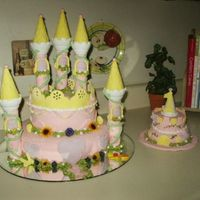 Castle B-Day Cake With Smash Cake   Yellow/strawberry and chocolate cake with MMF. MMF details. Small smash castle covered w/MMF and some handpainted details.