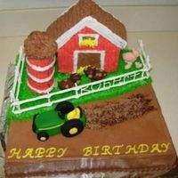 John Deere This is frosted in buttercream with a royal icing fence. The tractor and animals are fondant. I made the silo out of cookies on a dowel rod...