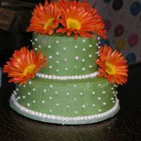 Gerber Daisy Cake This a cake that I made for my 30th birthday. The top cake is a strawberry/pecan cake and the bottom cake is a banana/pineapple cake. The...