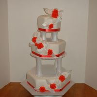 Red Rose Hexagon Wedding Cake Three tier hexagon shaped wedding cake. Covered with fondant and fondant roses.
