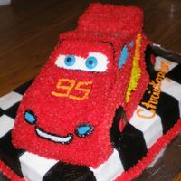 Lightening Mcqueen Started w/ the Wilton Cruiser car pan and made alterations to make it look more like a race car. It's all done with buttercream icing...