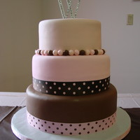 Pink And Brown 8, 10, and 12 in round covered with fondant