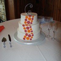 Round 8, 10, 12 in buttercream with fondant orange and magenta dots